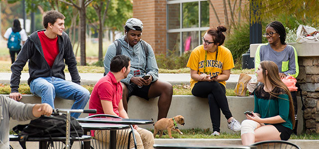 Students sitting around campus lounging and talking